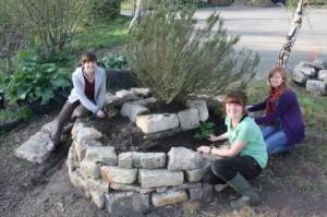 Volunteers working on the new herb spiral